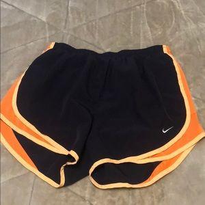 purple and orange nike shorts